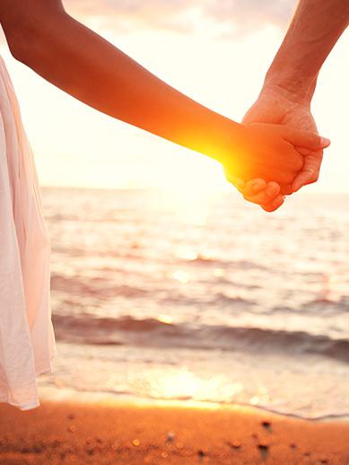 Couple walking along a beach
