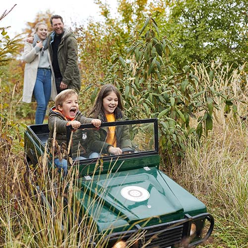 Children playing in miniature jeep at Center Parcs