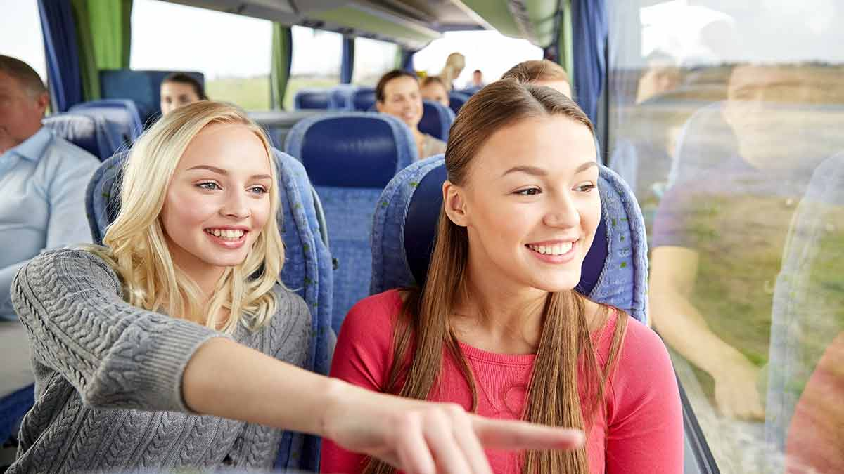 Club and Society Travel, two girls on a coach trip