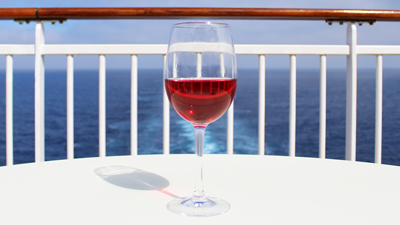 Sun deck bar - glass of wine on a table outside in the sun